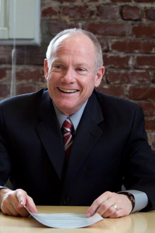 Happy chairman headshot image